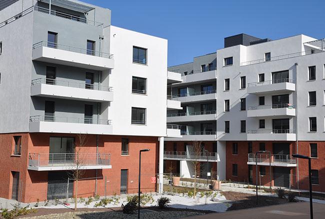 Réalisation de façades en grès rouge pour le quartier Montauban à Toulouse.